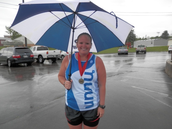 umbrella and a medal make for a happy runner.